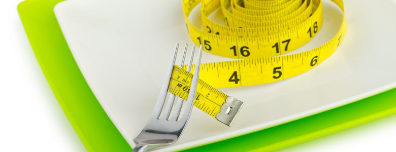 hudson weight loss - tape measure on a fork