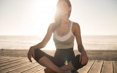 woman doing yoga during sunset
