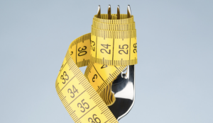 a photo of a tape measure wrapped in a fork